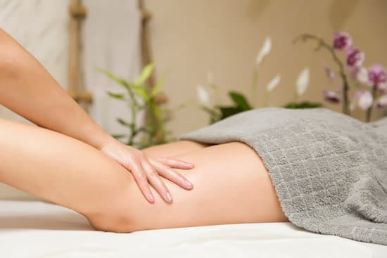 Woman getting leg massage in the spa center