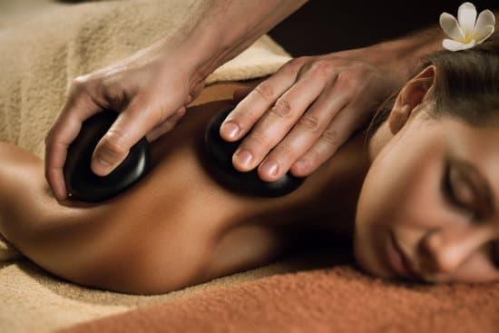 Massage with hot basalt stones. Beautiful deep charming light.